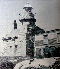 Lighthouse in early 1900s with a wooden extension